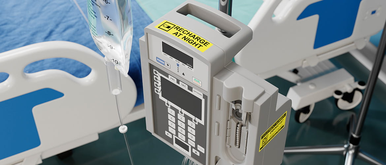 Medizinisches Gerät an Krankenbett mit Tropf