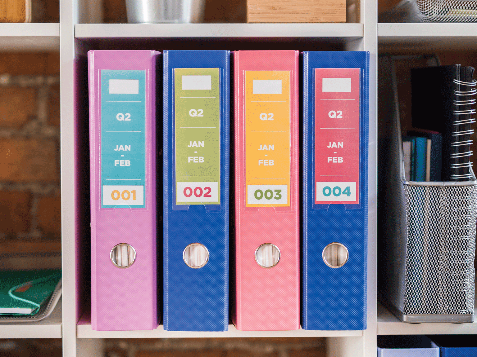 Brother full colour labels on file folders in office shelving unit