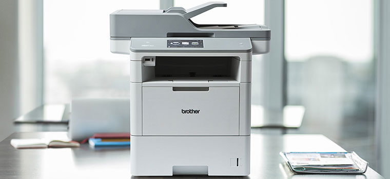 MFC-L6900DW mono laser business printer on desk in office