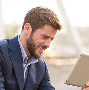Brother OmniJoin man outside holding tablet with web conference